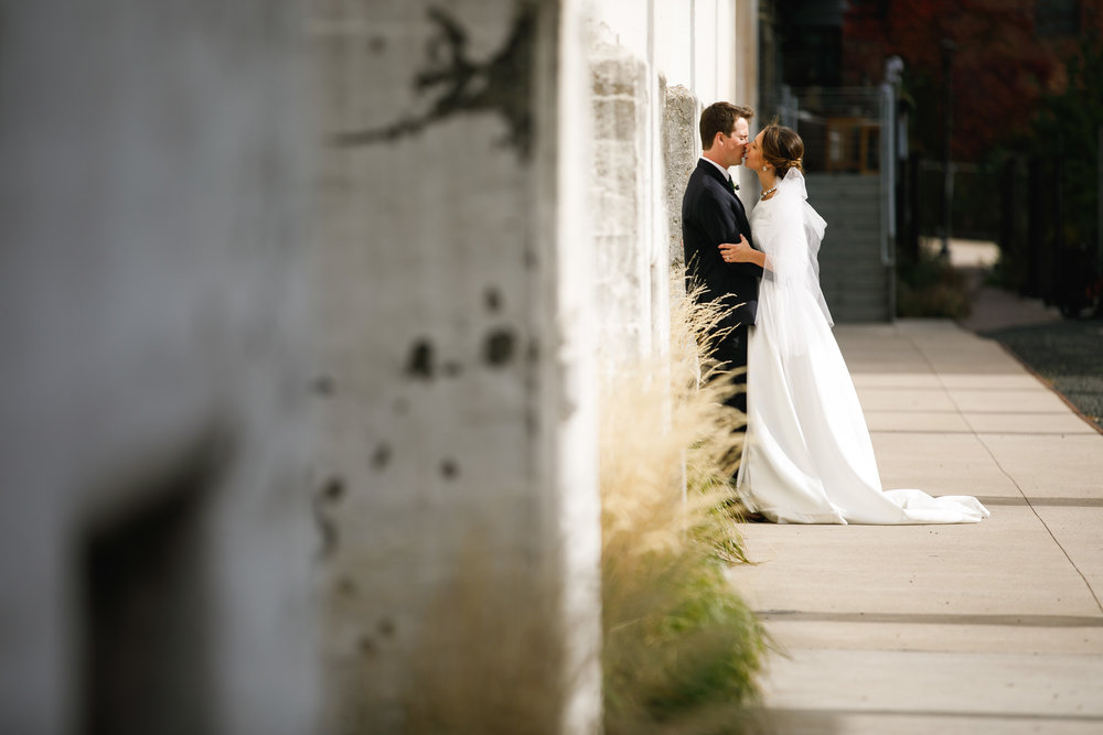 Brovado Wedding Photography | Machine Shop Minneapolis | Sixpence Events Day of Coordinating | bride and groom side of historic building | St. Anthony Main.jpg