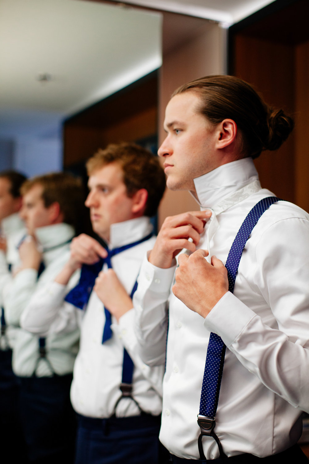 How to Capture Your Getting Ready Photos | Leah Fontaine Photography | Getting ready photos with groomsmen in white shirts and suspenders