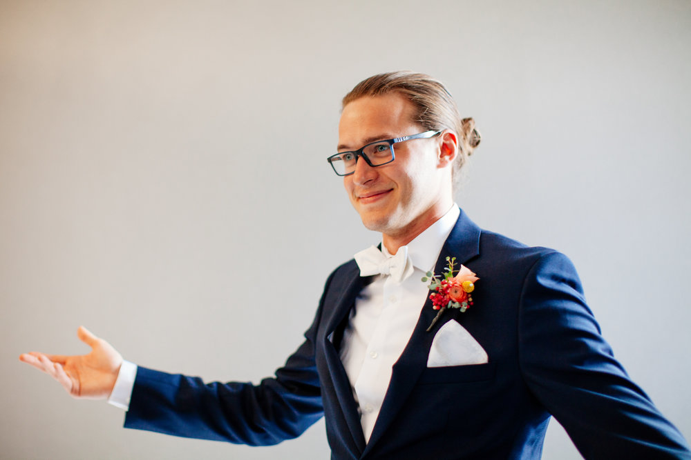 How to Capture Your Getting Ready Photos | Leah Fontaine Photography | Getting ready photos groom with glasses and man bun
