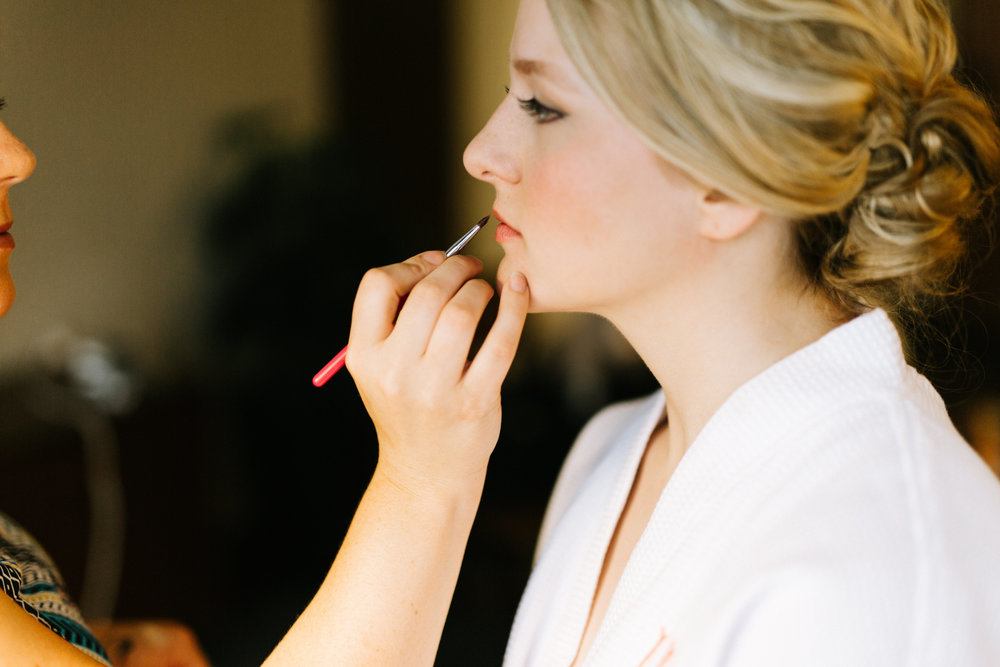 Lydia + Michael Sixpence Events day of coordinating client | Loring Social | Kate Becker Photography | Mann Frau Videography | Minted wedding stationery | getting ready photo at the hotel bride in a white robe with a blonde low bun