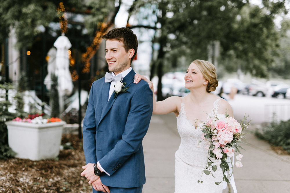 Lydia + Michael Sixpence Events day of coordinating client | Loring Social | Kate Becker Photography | Mann Frau Videography | Minted wedding stationery | first look outside of Cafe Lurcat
