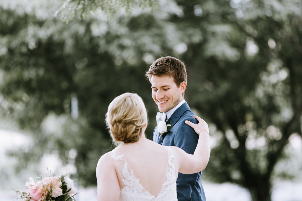 Lydia + Michael Sixpence Events day of coordinating client | Loring Social | Kate Becker Photography | Mann Frau Videography | Minted wedding stationery | first look bride with v neck dress dainty back detail
