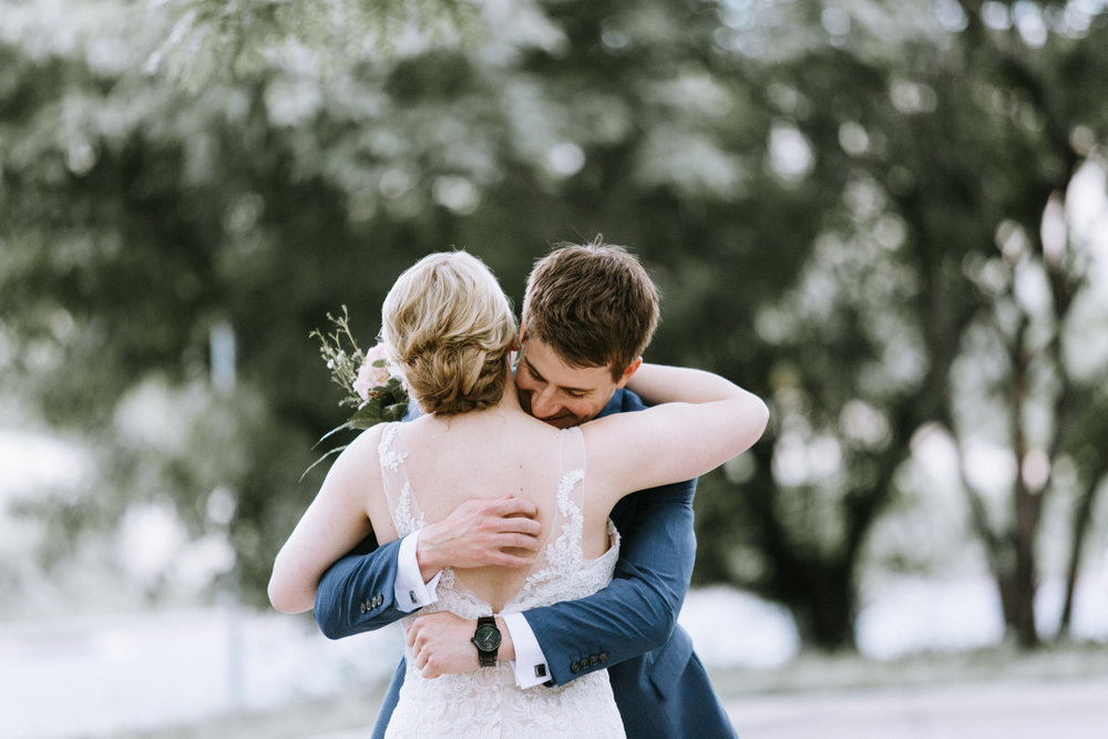 Lydia + Michael Sixpence Events day of coordinating client | Loring Social | Kate Becker Photography | Mann Frau Videography | Minted wedding stationery | bride and groom hugging first look groom in true blue suit with black watch