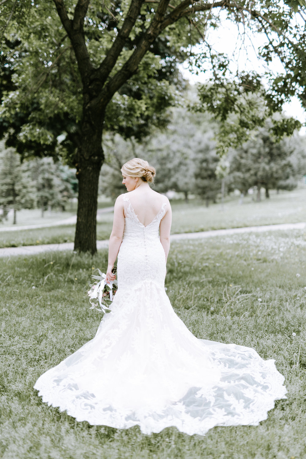 Lydia + Michael Sixpence Events day of coordinating client | Loring Social | Kate Becker Photography | Mann Frau Videography | Minted wedding stationery | bridal gown train with lace overlay