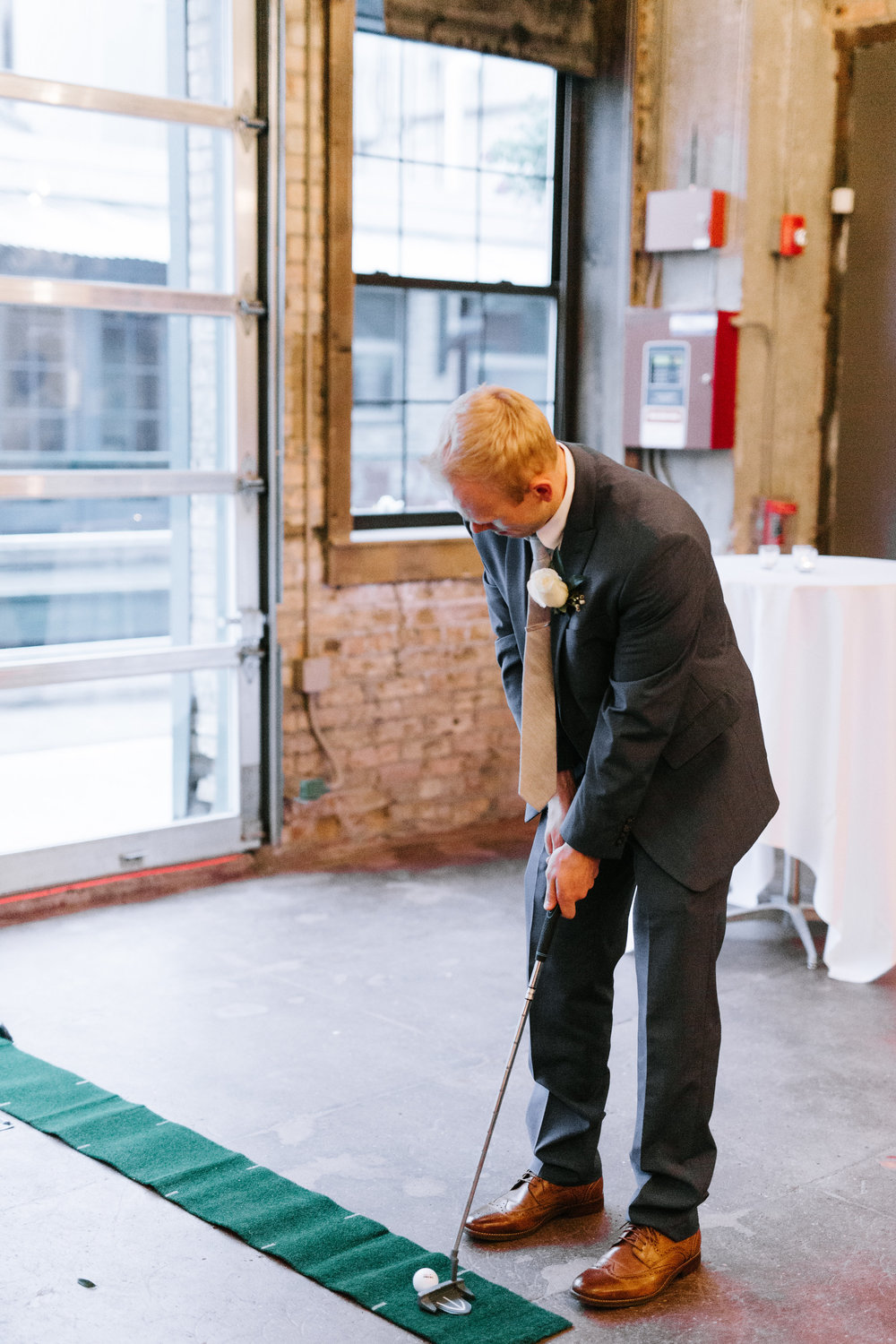 Lydia + Michael Sixpence Events day of coordinating client | Loring Social | Kate Becker Photography | Mann Frau Videography | Minted wedding stationery | whole in one put putt instead of clinking glass for a kiss
