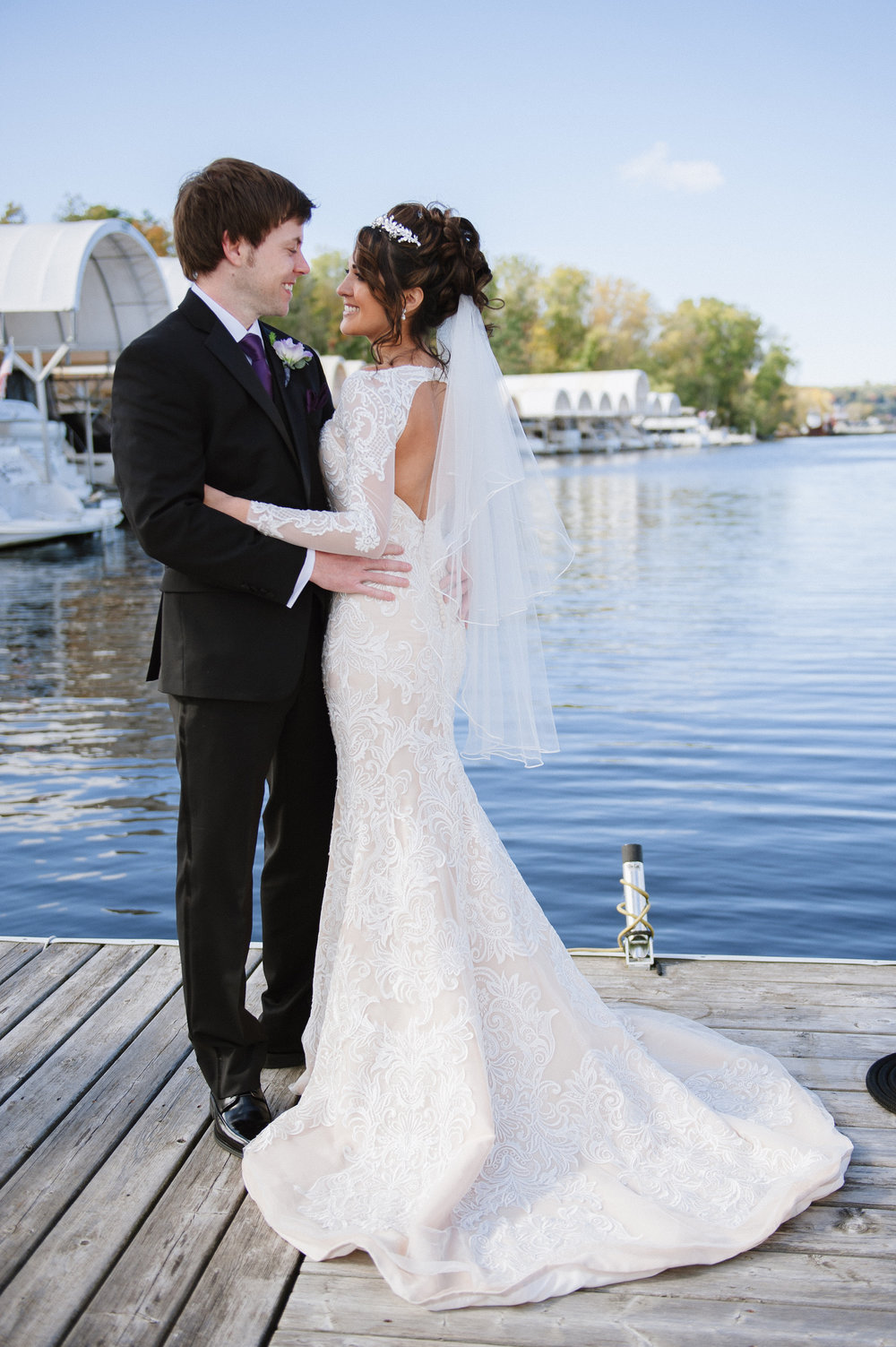 bride and groom portraits on the dock | St. Croix river | tiara bridal hair piece | Dillinger Studios Minneapolis Photographer | Mexican American fusion wedding | Sixpence Events & Planning Minnesota wedding planner .jpg