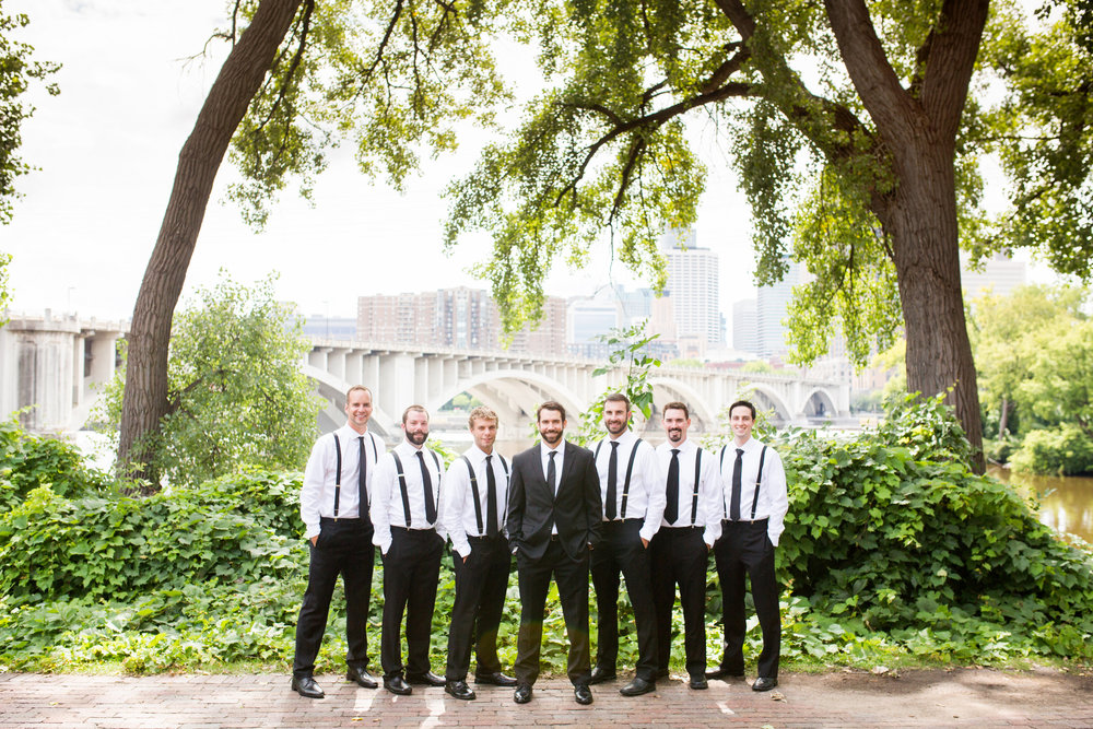 Kaylie + Travis | Sixpence Events wedding planner in the midwest | Studio KH photography | groomsmen with black suspenders and black pants at Nicollet Island
