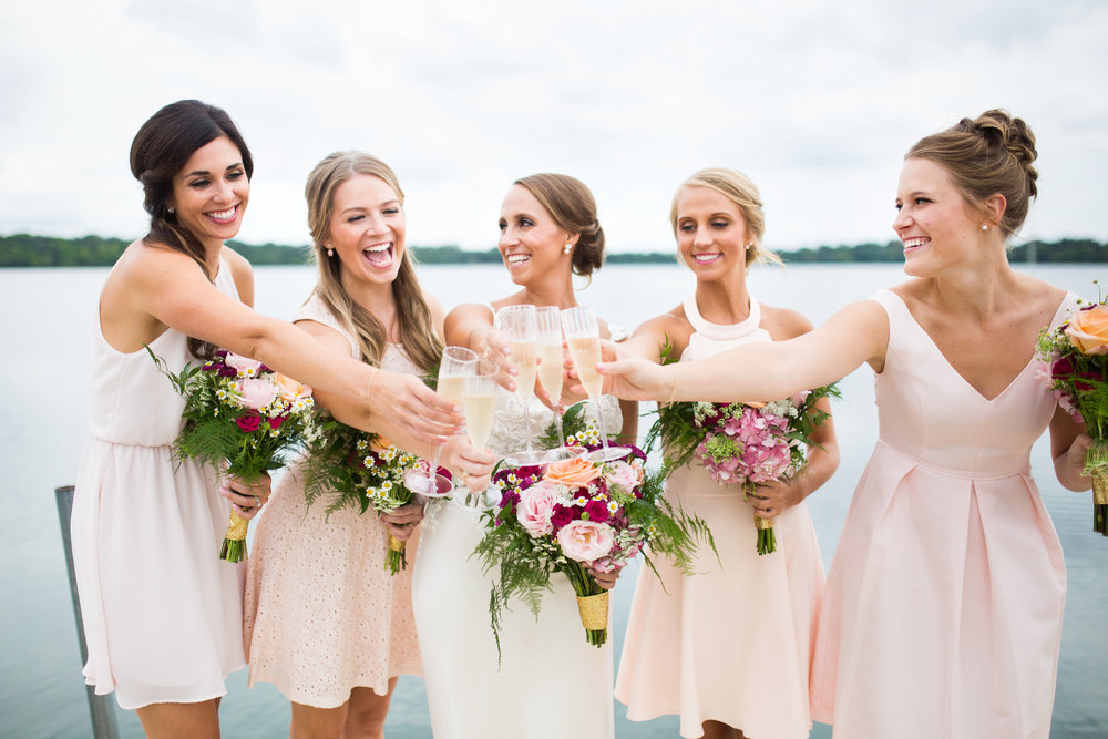 Kaylie + Travis | Sixpence Events wedding planner in the midwest | Studio KH photography | cheers on the dock at Lake Harriet