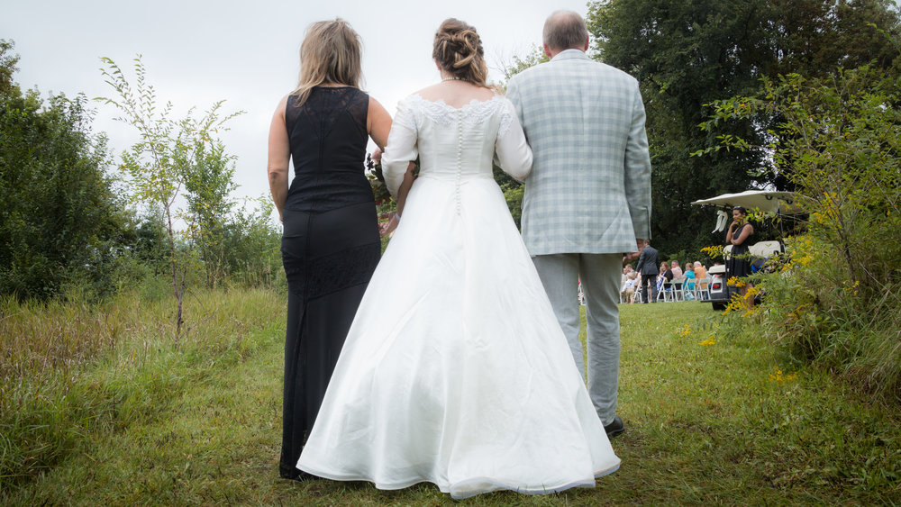 bride escorted by mom and dad // Backyard Wedding in Northfield, MN :: Elliot Malcom Photography :: Megan + Andrew :: Apres Tent Rental :: GastroTruck Catering :: Sixpence Events & Planning .jpg