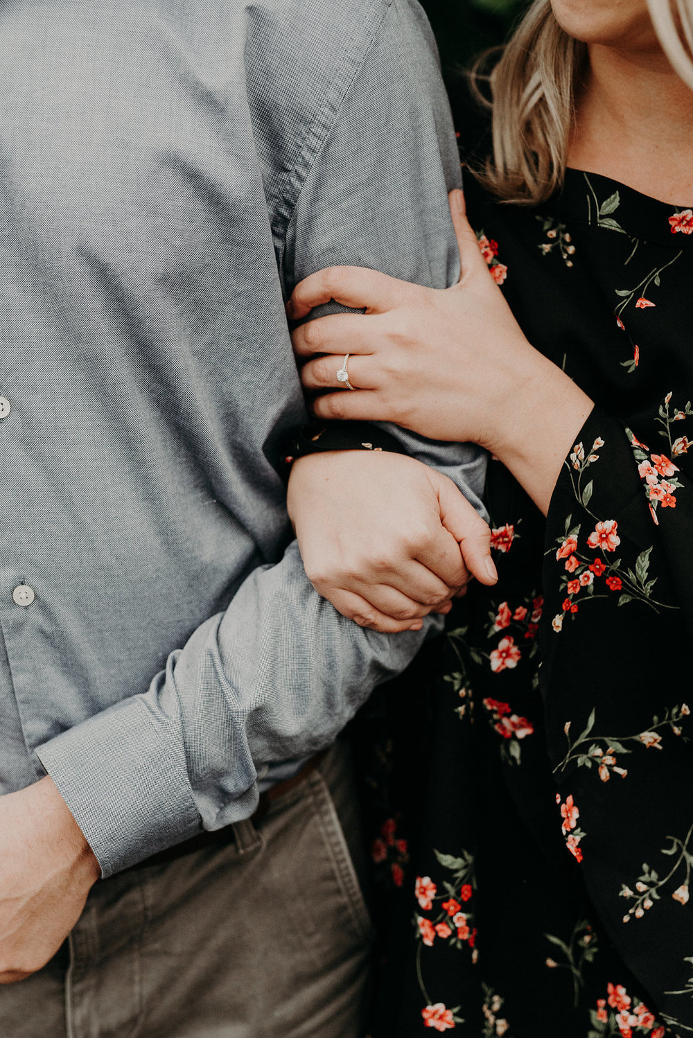 Ali Leigh Photo | Engagement shoot in the fall at Psycho Suzi's in Minneapolis | groom in denim button down | bride in black long sleeve floral print | solitaire with diamond band | Sixpence wedding blog with free wedding planning advice