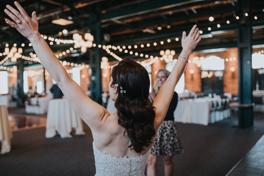 bride with toned back | first look of the reception room | cafe string lights | bride with down do | hair pins | Russell Heeter Photography :: Minneapolis wedding planner Sixpence Events :: Nicollet Island Pavilion :: april wedding in Minnesota.jpg