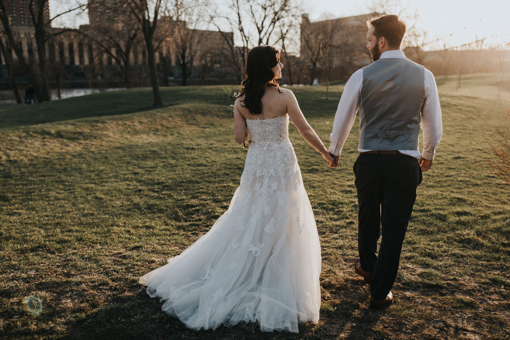 golden hour photos | unbustled wedding dress | Russell Heeter Photography :: Minneapolis wedding planner Sixpence Events :: Nicollet Island Pavilion :: april wedding in Minnesota.jpg
