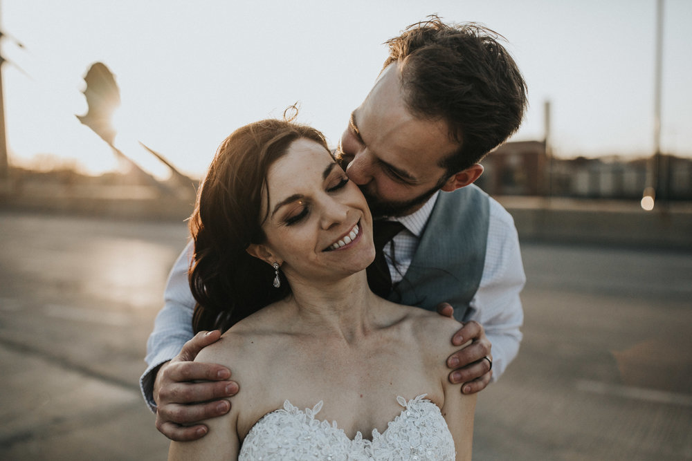 temple kiss the best kind | Primped hair and makeup | Russell Heeter Photography :: Minneapolis wedding planner Sixpence Events :: Nicollet Island Pavilion :: april wedding in Minnesota.jpg