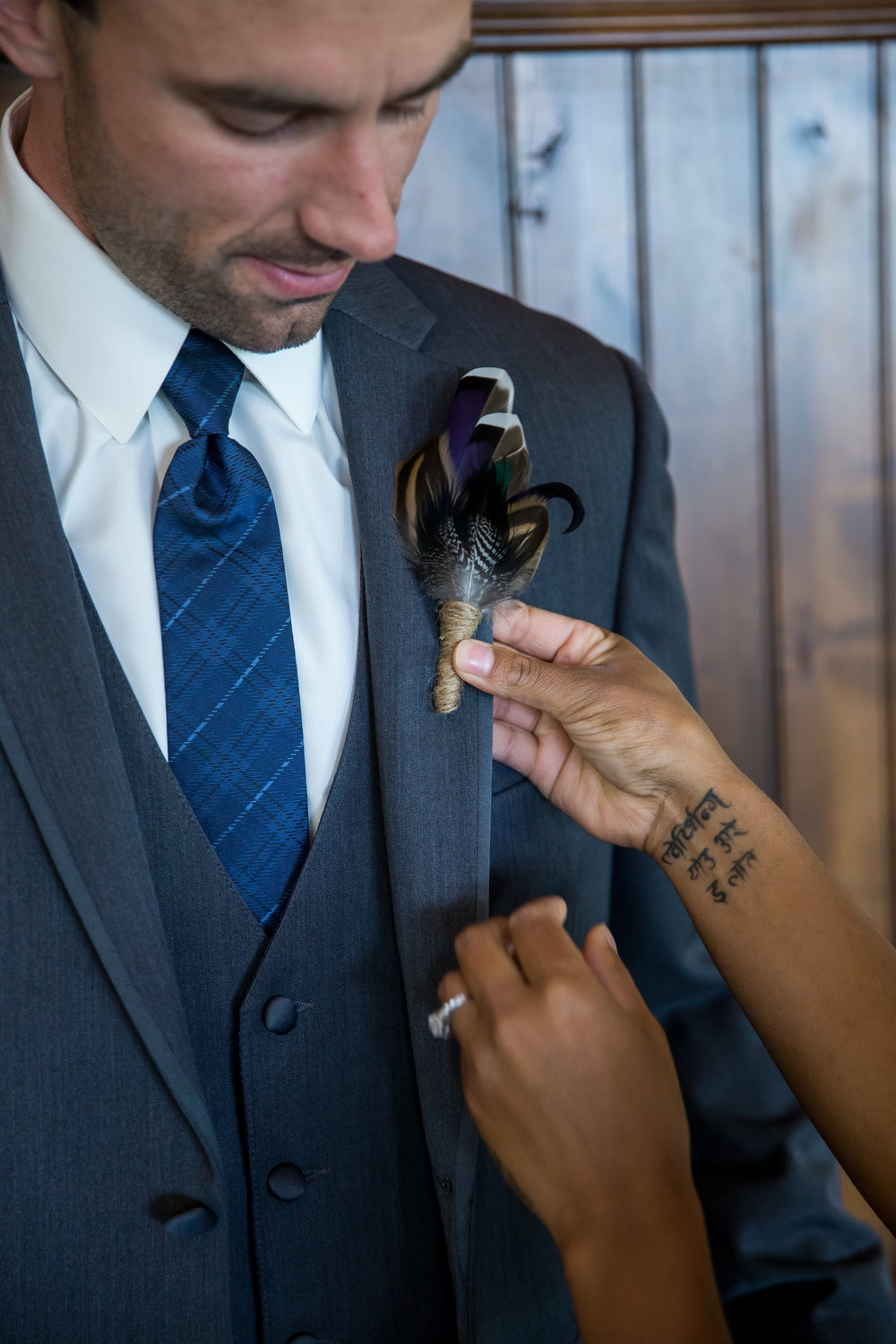 boutonniere pinning, duck feathers | Kelly Birch Photography :: Horse and Hunt Club :: Sixpence Events Minnesota wedding planner .jpg
