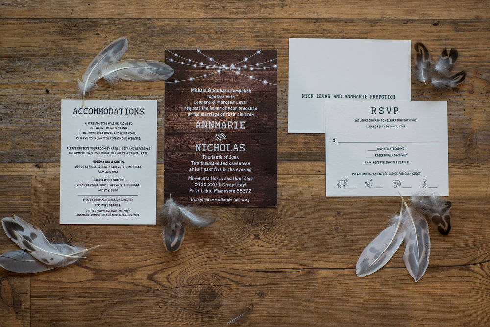invitation suite with duck feathers | Kelly Birch Photography :: Horse and Hunt Club :: Sixpence Events Minnesota wedding planner .jpg