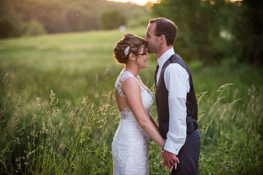 golden hour field photo with the mosquitos | Kelly Birch Photography :: Horse and Hunt Club :: Sixpence Events Minnesota wedding planner .jpg