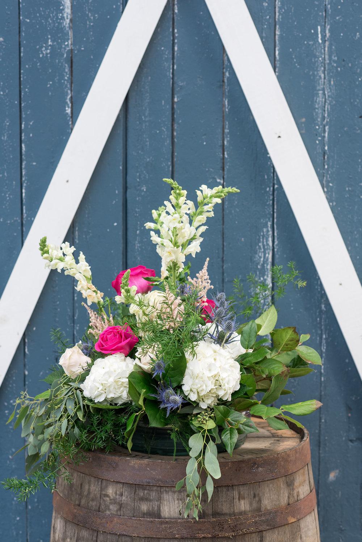 wine barrel flower | Kelly Birch Photography :: Bloom Lake Barn :: Sixpence Events Minnesota wedding planner :: A Vintage Touch Weddings :: Brett Dorian.jpg