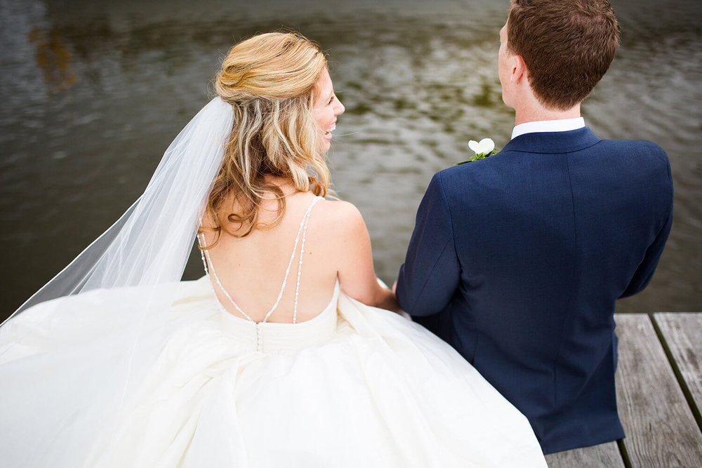 sitting on the dock - strappy dress \ hair half up \ Minnesota wedding photographer Studio KH wedding dress details | wedding blog | Sixpence Events 70 Ways to Photograph Your Wedding Dress.jpg