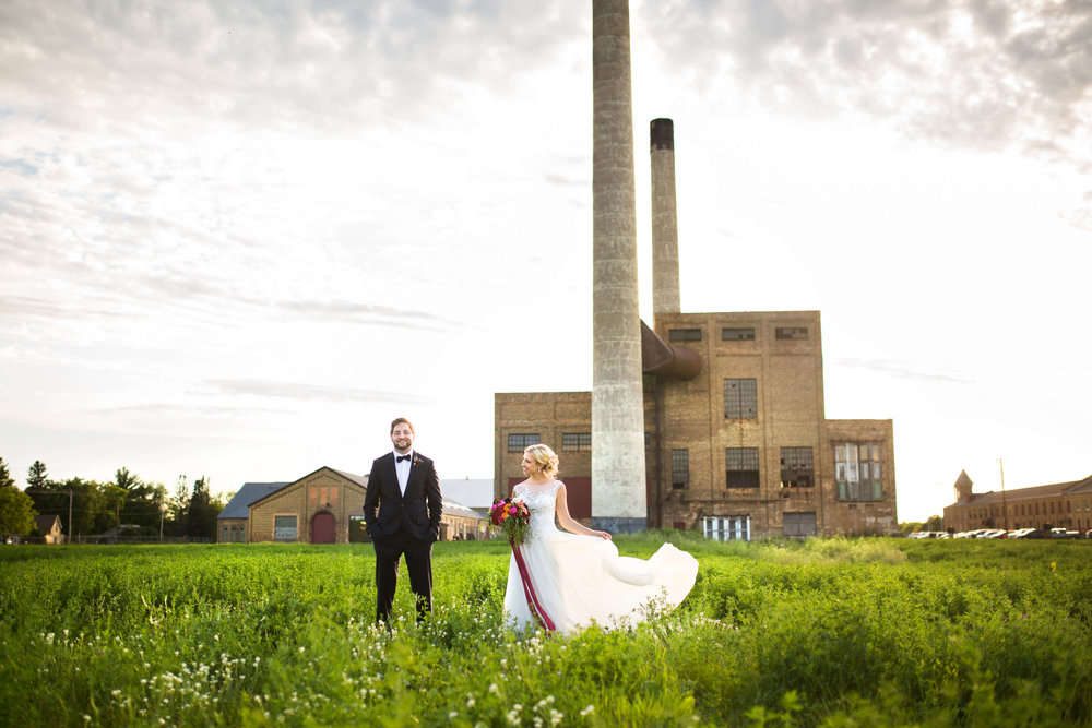 bride and groom in the tall grasses | Minnesota wedding photographer Studio KH wedding dress details | wedding blog | Sixpence Events 70 Ways to Photograph Your Wedding Dress.jpg