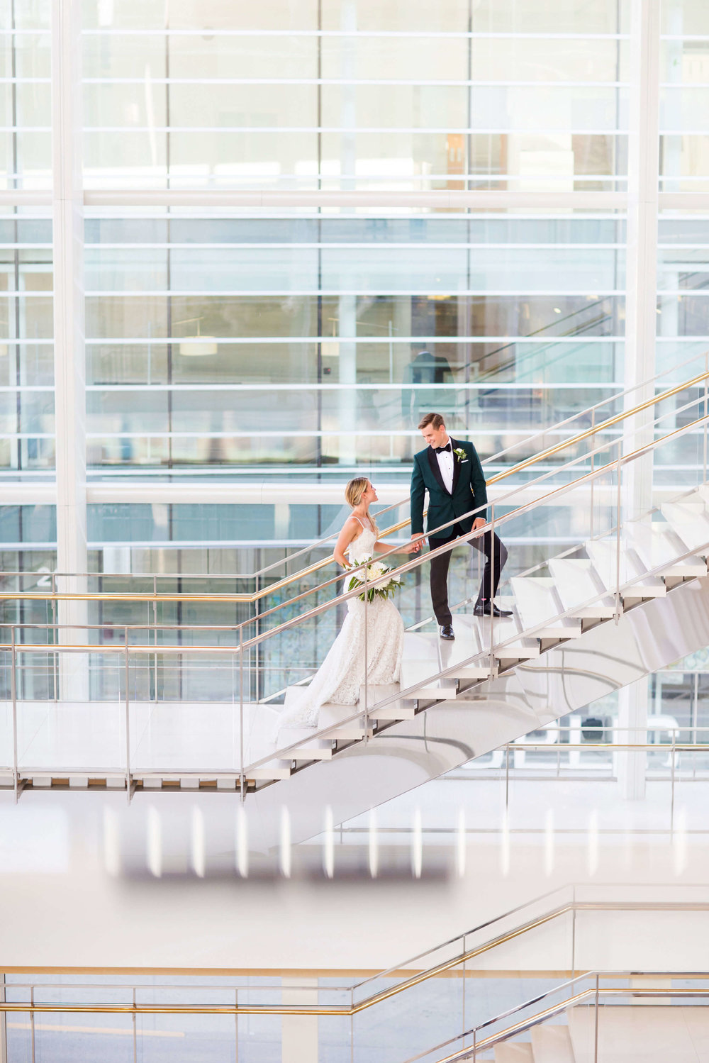 bride and groom walking up the stairs | Minnesota wedding photographer Studio KH wedding dress details | wedding blog | Sixpence Events 70 Ways to Photograph Your Wedding Dress.jpg