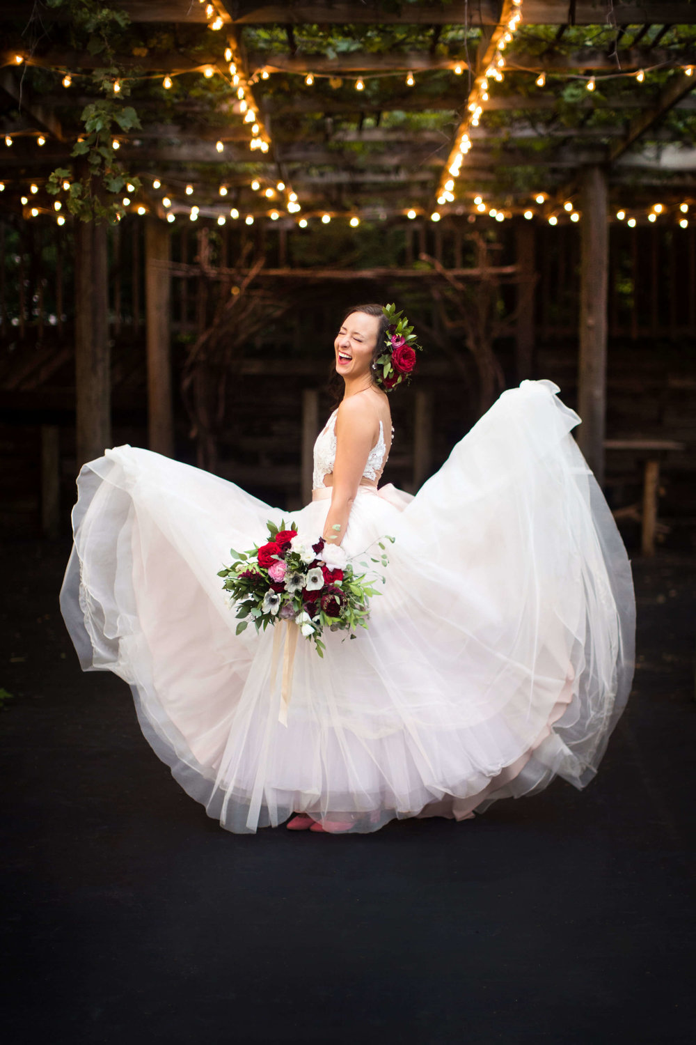 brides dress flipped up! anemone bouquet with bride red blooms and scabiosa flowers | Minnesota wedding photographer Studio KH wedding dress details | wedding blog | Sixpence Events 70 Ways to Photograph Your Wedding Dress.jpg