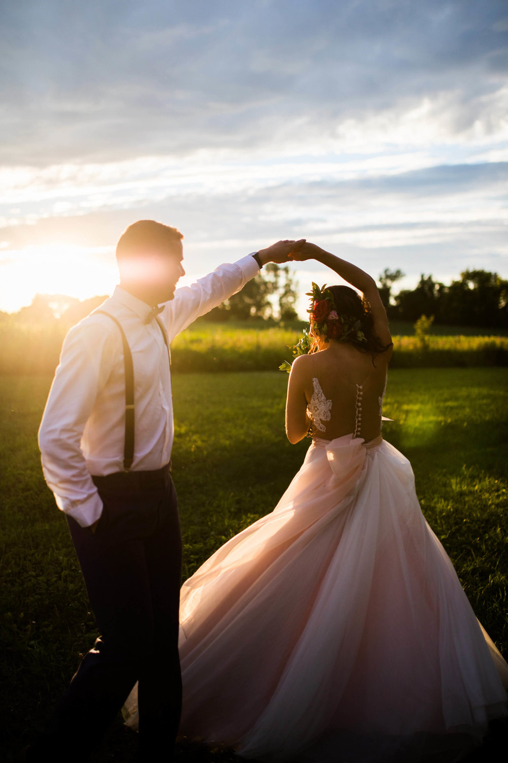 groom twirling bride | pink tulle | sunset | Minnesota wedding photographer Studio KH wedding dress details | wedding blog | Sixpence Events 70 Ways to Photograph Your Wedding Dress.jpg