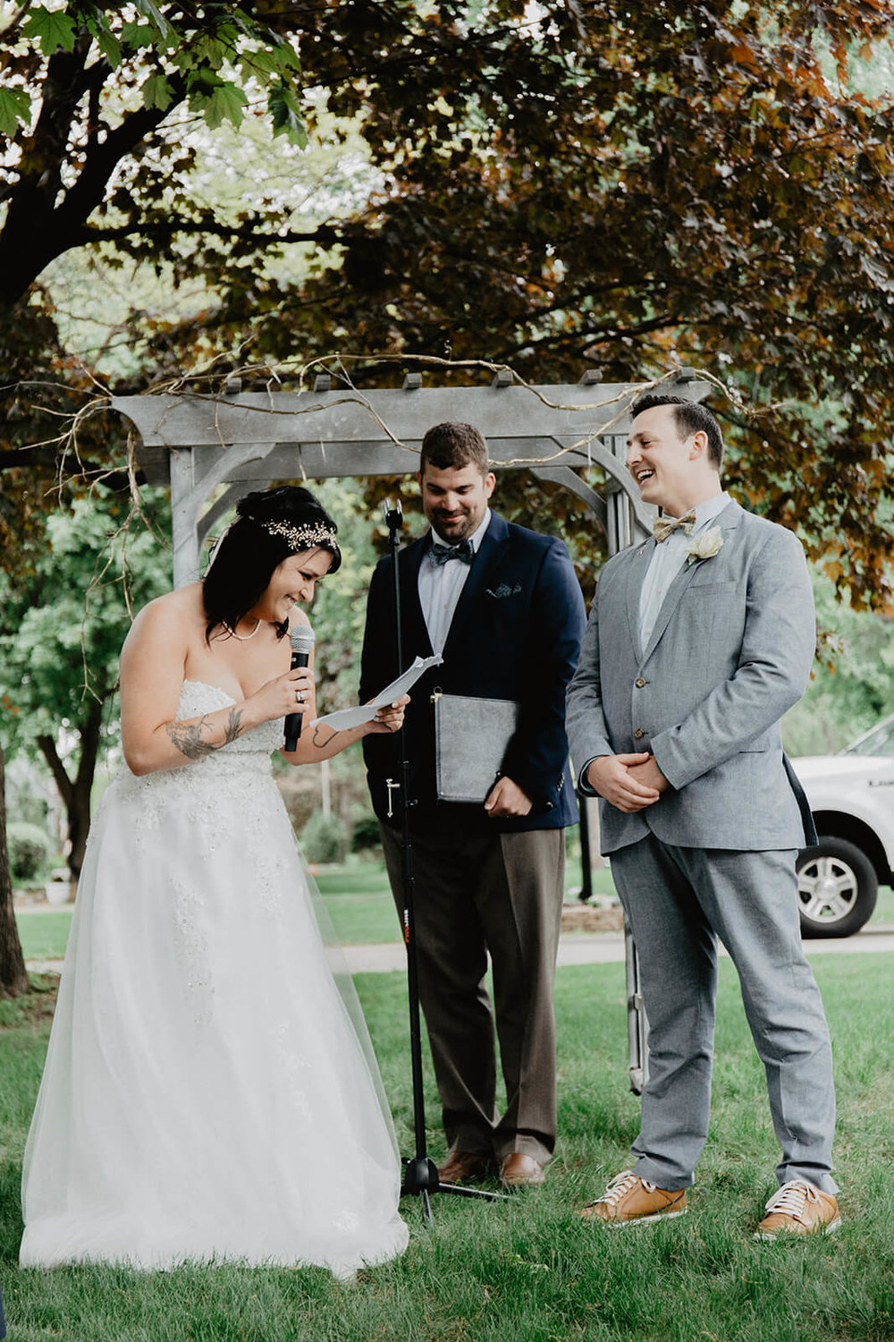 Alex + Lisi -- backyard Minnesota wedding -- Mads Lizotte photography -- Sixpence Events -- reading vows.jpg
