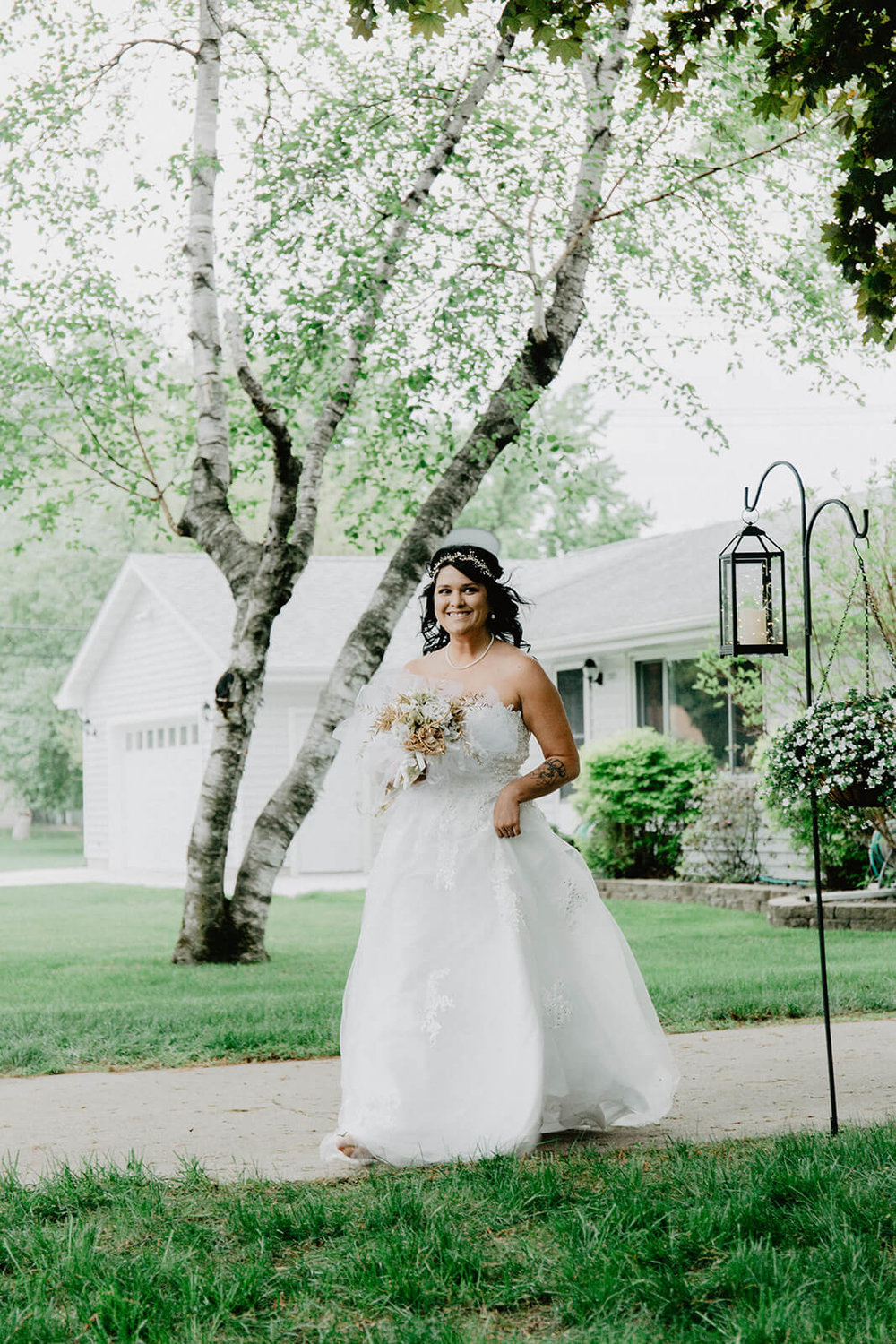 Alex + Lisi -- backyard Minnesota wedding -- Mads Lizotte photography -- Sixpence Events -- bride processional solo.jpg