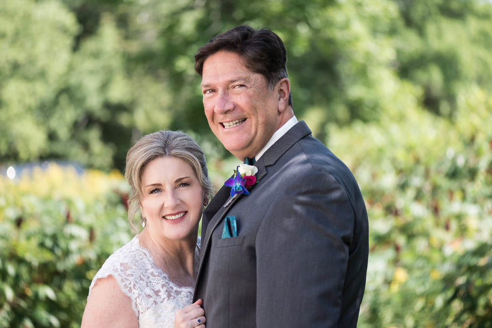 K Solberg Photography | Elm Creek Chalet | Minneapolis day of coordinator Sixpence Events | bride and groom with a teal pocket square