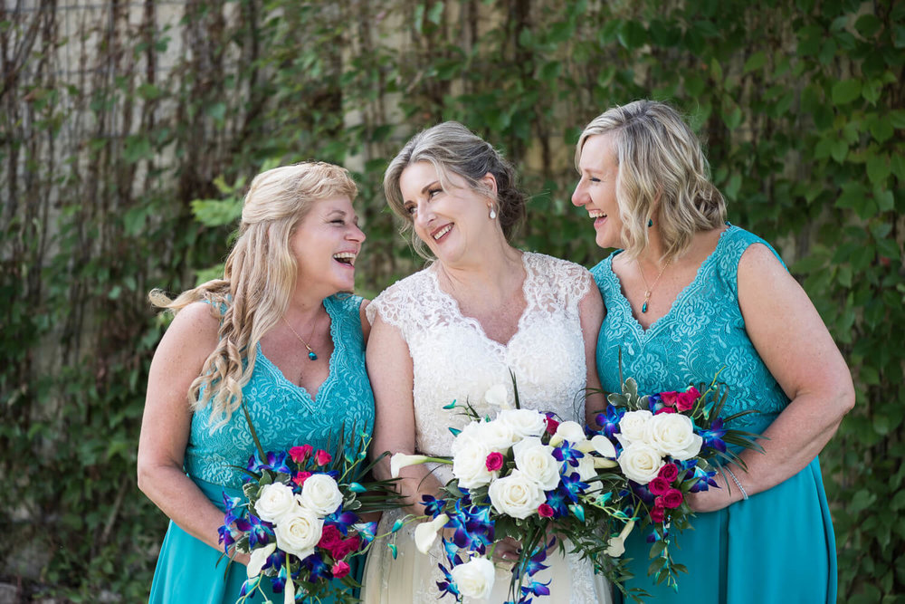 K Solberg Photography | Elm Creek Chalet | Minneapolis day of coordinator Sixpence Events | teal bridesmaids bouquets with v neck lace dress