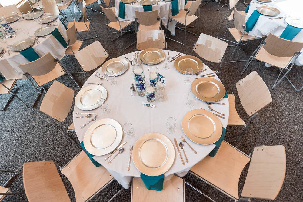 K Solberg Photography | Elm Creek Chalet | Minneapolis day of coordinator Sixpence Events | silver charger with white table cloth and teal table drop napkin