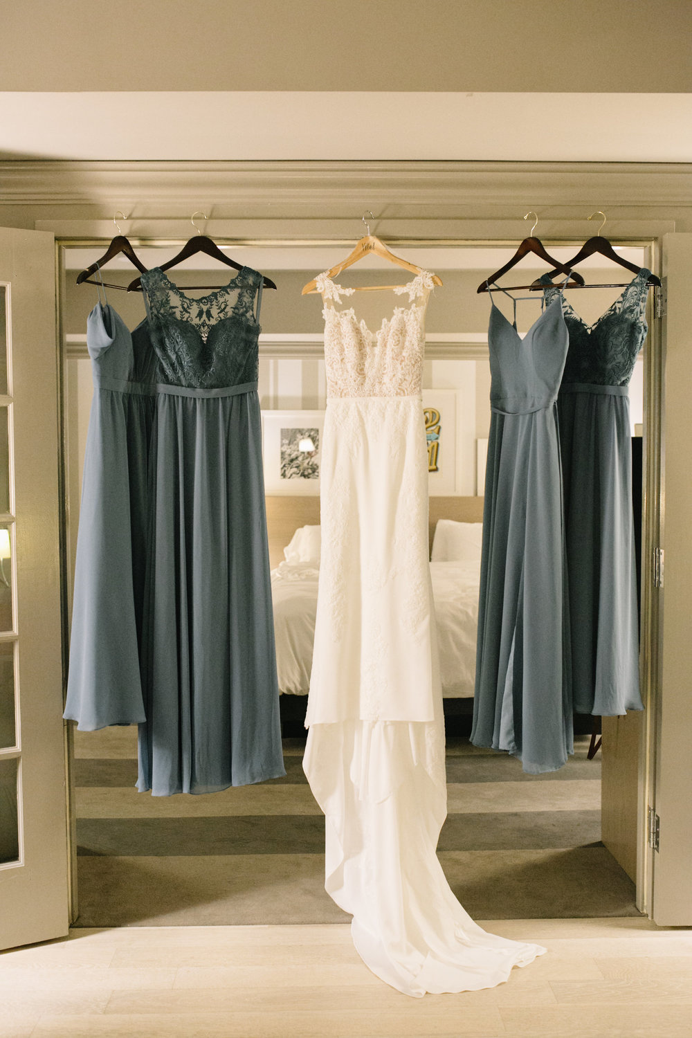 dresses hanging up::  Whims and Joy Minneapolis photographer :: Sixpence Events & Planning Minnesota wedding planner :: Nicollet Island Pavilion.jpg