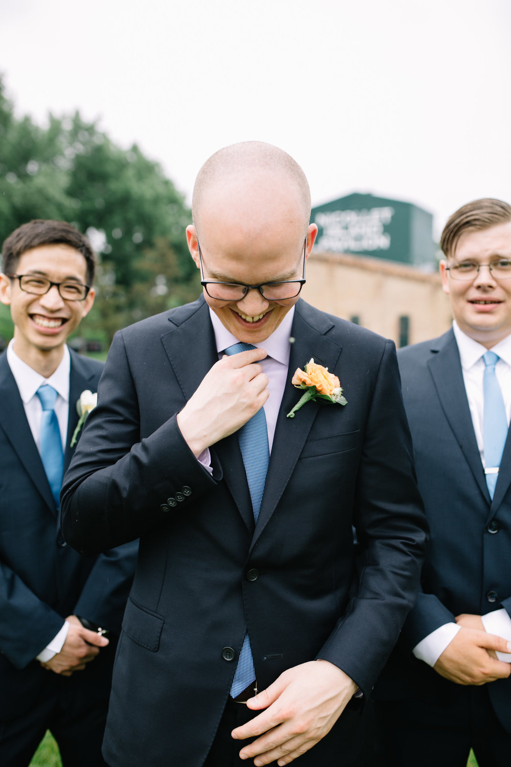 groom in bright blue tie, glasses, and bright boutonniere, Whims and Joy Minneapolis photographer :: Sixpence Events & Planning Minnesota wedding planner :: Nicollet Island Pavilion.jpg