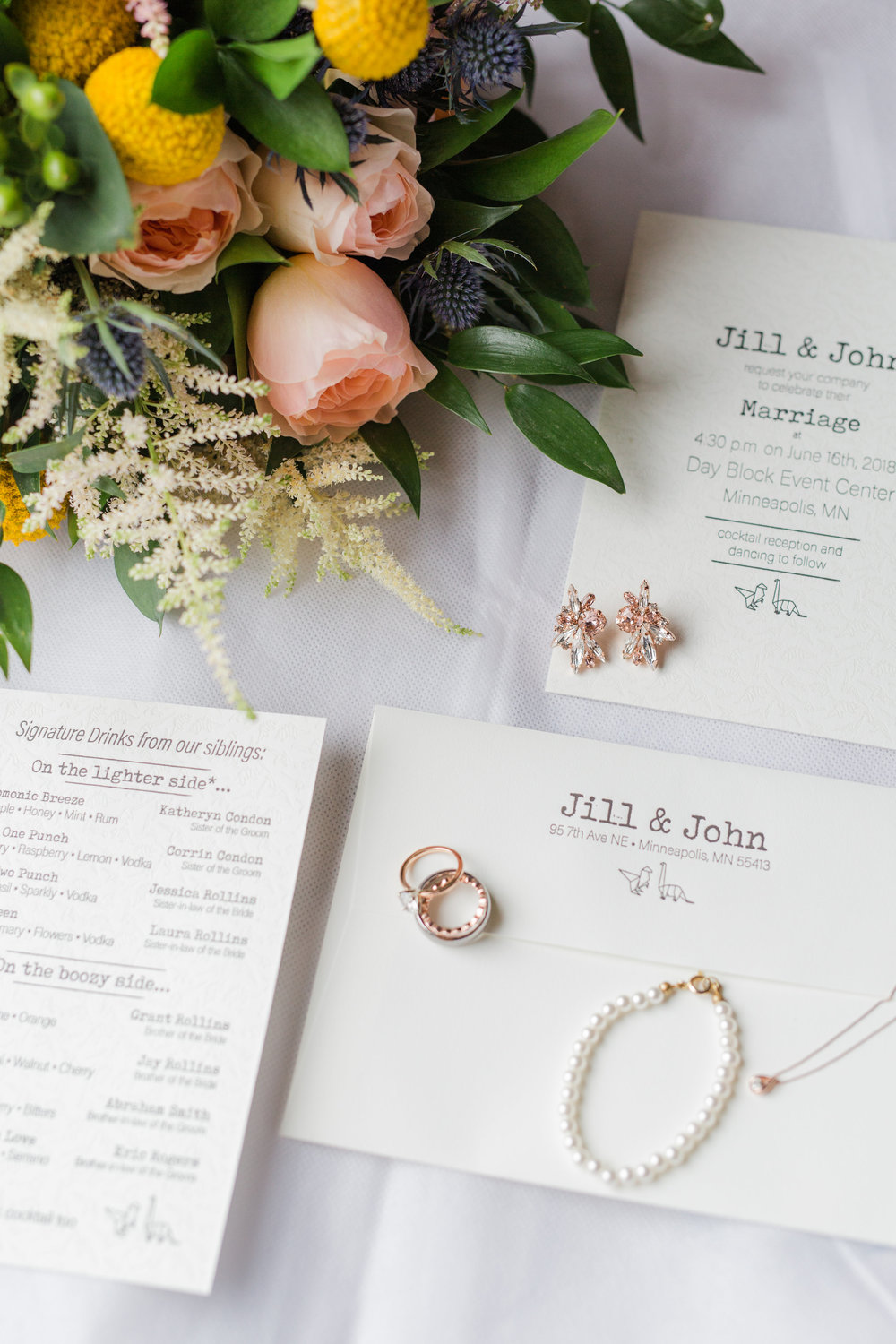 Jill + John :: Kristen Dyer :: Sixpence Events details photo | paper crane dinosaurs, letter press, rose gold, white astilbe and italian ruscus with blue thistle