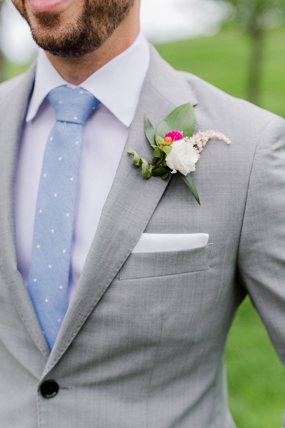 Jill + John :: Kristen Dyer :: Sixpence Events, boutonniere with pop of pink on grey suit with white pocket square and blue polka dot tie