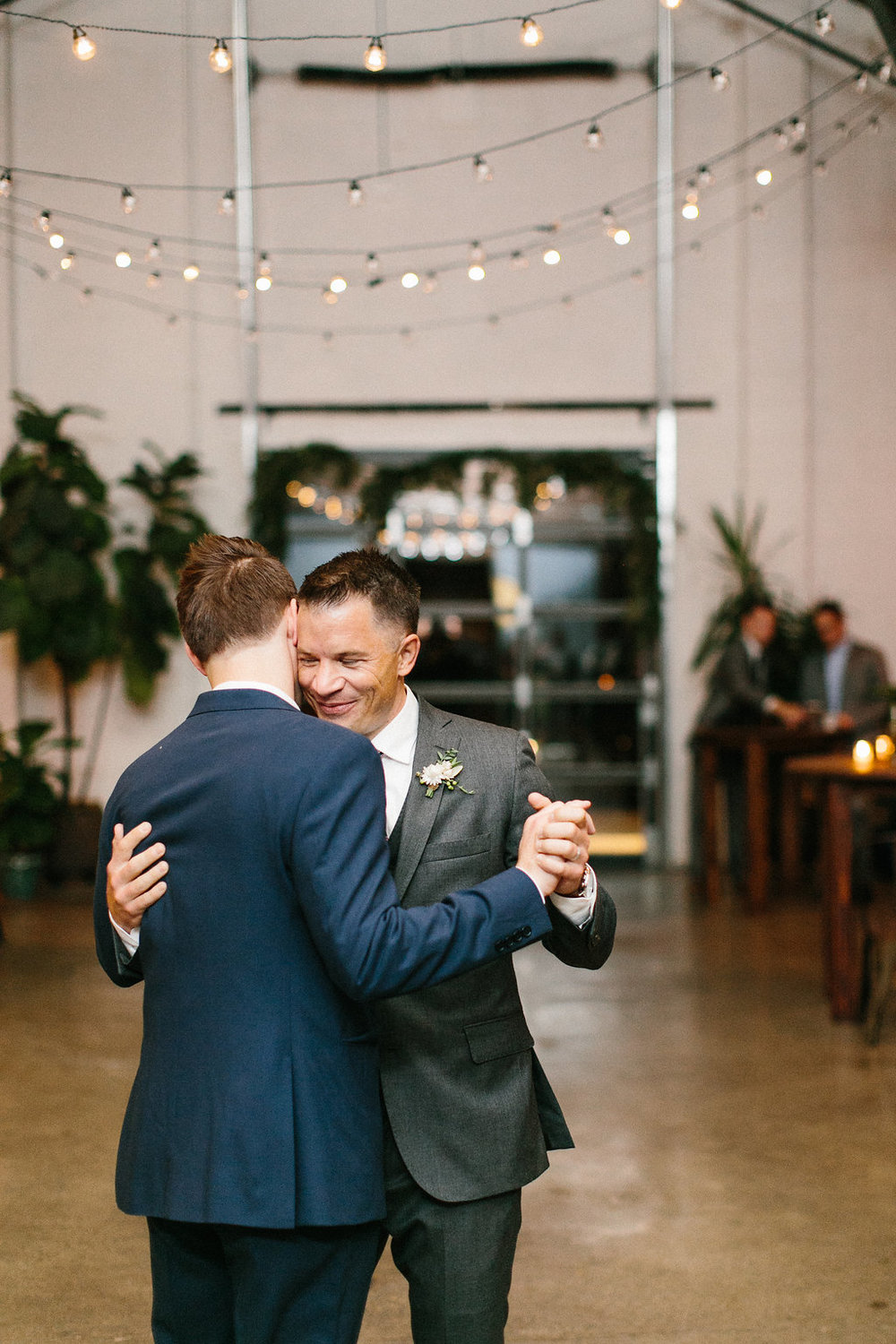 Carly Milbrath Photography | Justin and Jacob | PAIKKA Minnesota Wedding Venue | Same sex wedding with two grooms, first dance as husbands