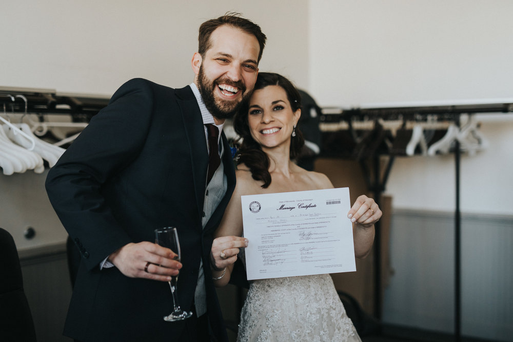 marriage license signed! Russell Heeter Photography :: Minneapolis wedding planner Sixpence Events :: Nicollet Island Pavilion :: april wedding in Minnesota.jpg