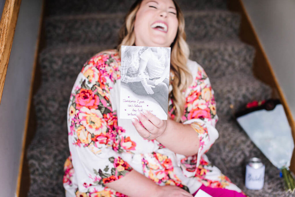 Laura Haya Photography | Sixpence Events Day of Coordinating | Bunker Hills Event Center Minnesota | bride reading her groom's card