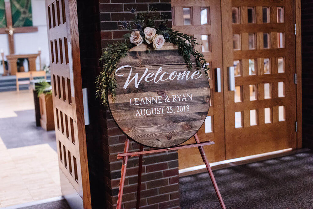 Laura Haya Photography | Sixpence Events Day of Coordinating | Bunker Hills Event Center Minnesota | round wood wedding welcome sign
