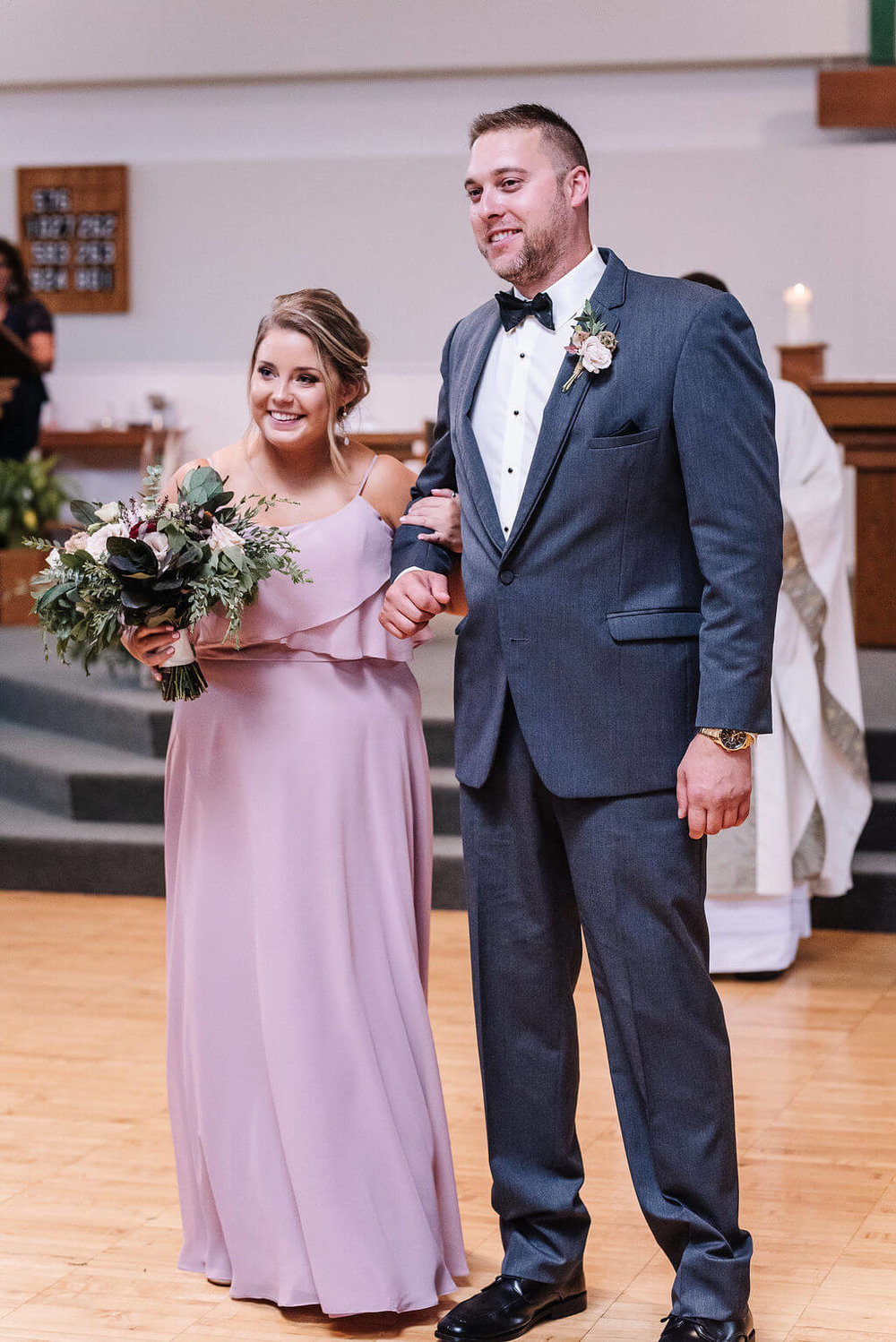 Laura Haya Photography | Sixpence Events Day of Coordinating | Bunker Hills Event Center Minnesota | lavender bridesmaid with blue suit bow tie groomsmen