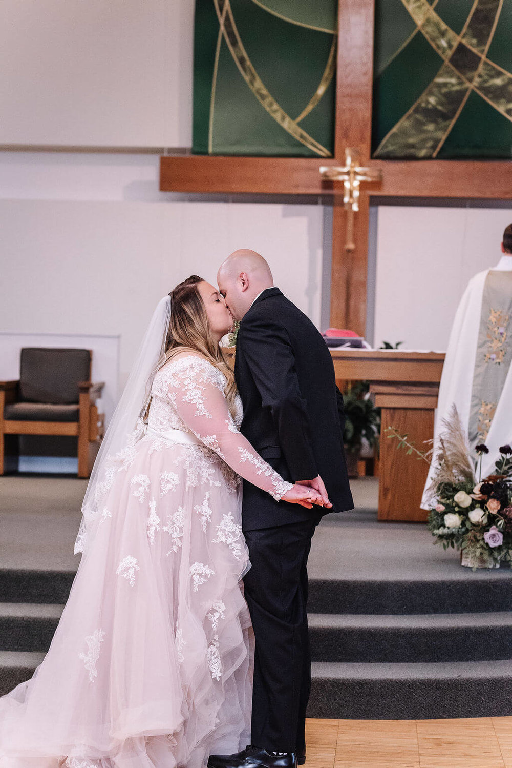 Laura Haya Photography | Sixpence Events Day of Coordinating | Bunker Hills Event Center Minnesota | first kiss at St. William's Church in Fridley