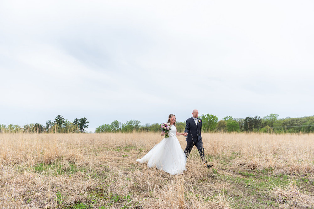 Sarah and Mark | Hope Glen Farm | Kelly Birch Photo | Sixpence Events & Planning wedding planning in Minnesota | walking in a field