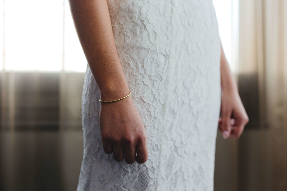 Roy Son Photography | Raspberry Island and Octo Fish bar | Minneapolis wedding planner Sixpence Events | lace bridal dress simple with simple gold bracelet