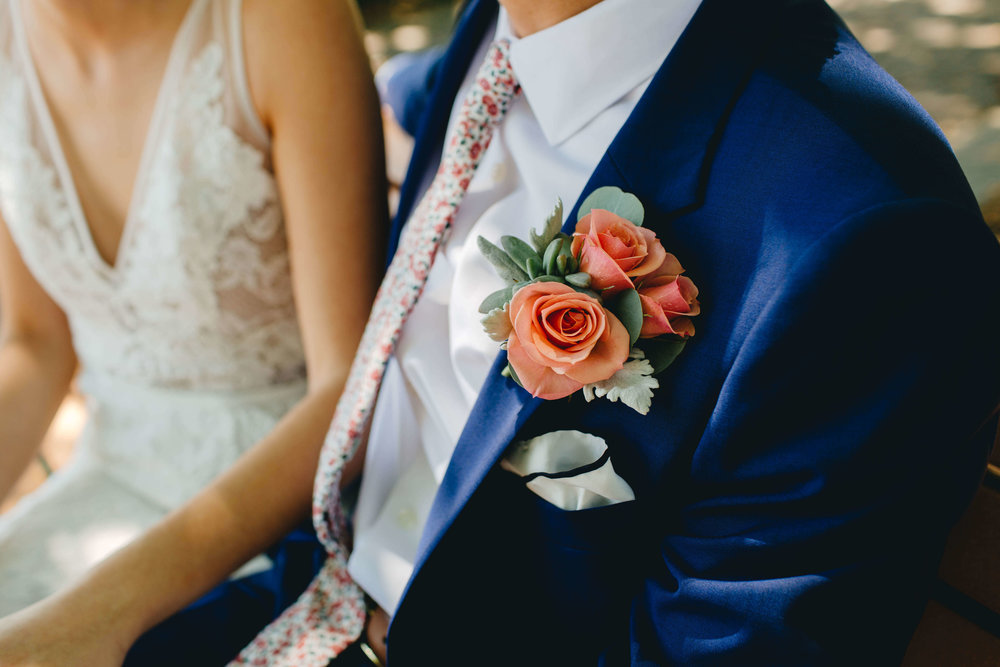 Roy Son Photography | Raspberry Island and Octo Fish bar | Minneapolis wedding planner Sixpence Events | coral boutonniere