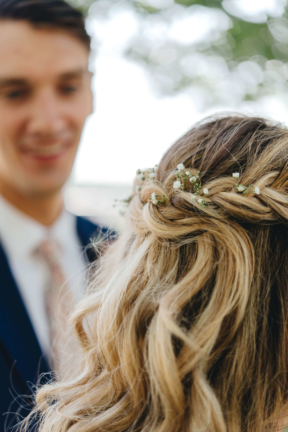 Roy Son Photography | Raspberry Island and Octo Fish bar | Minneapolis wedding planner Sixpence Events | babys breath in bridal braid