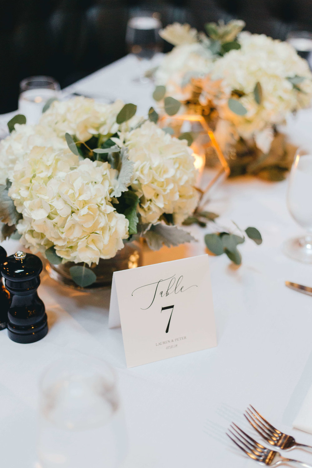 Roy Son Photography | Raspberry Island and Octo Fish bar | Minneapolis wedding planner Sixpence Events | Bachman's simple table centerpieces with white hydrangeas and table numbers