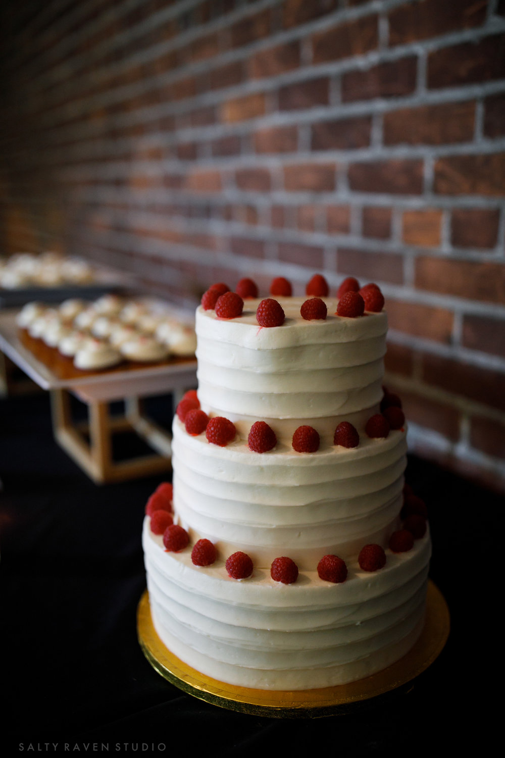 Copper Hen 3 tier cake with simple raspberry decor | Salty Raven Photography | PAIKKA | Sixpence Events | Eleanor and Aaron's wedding.jpg