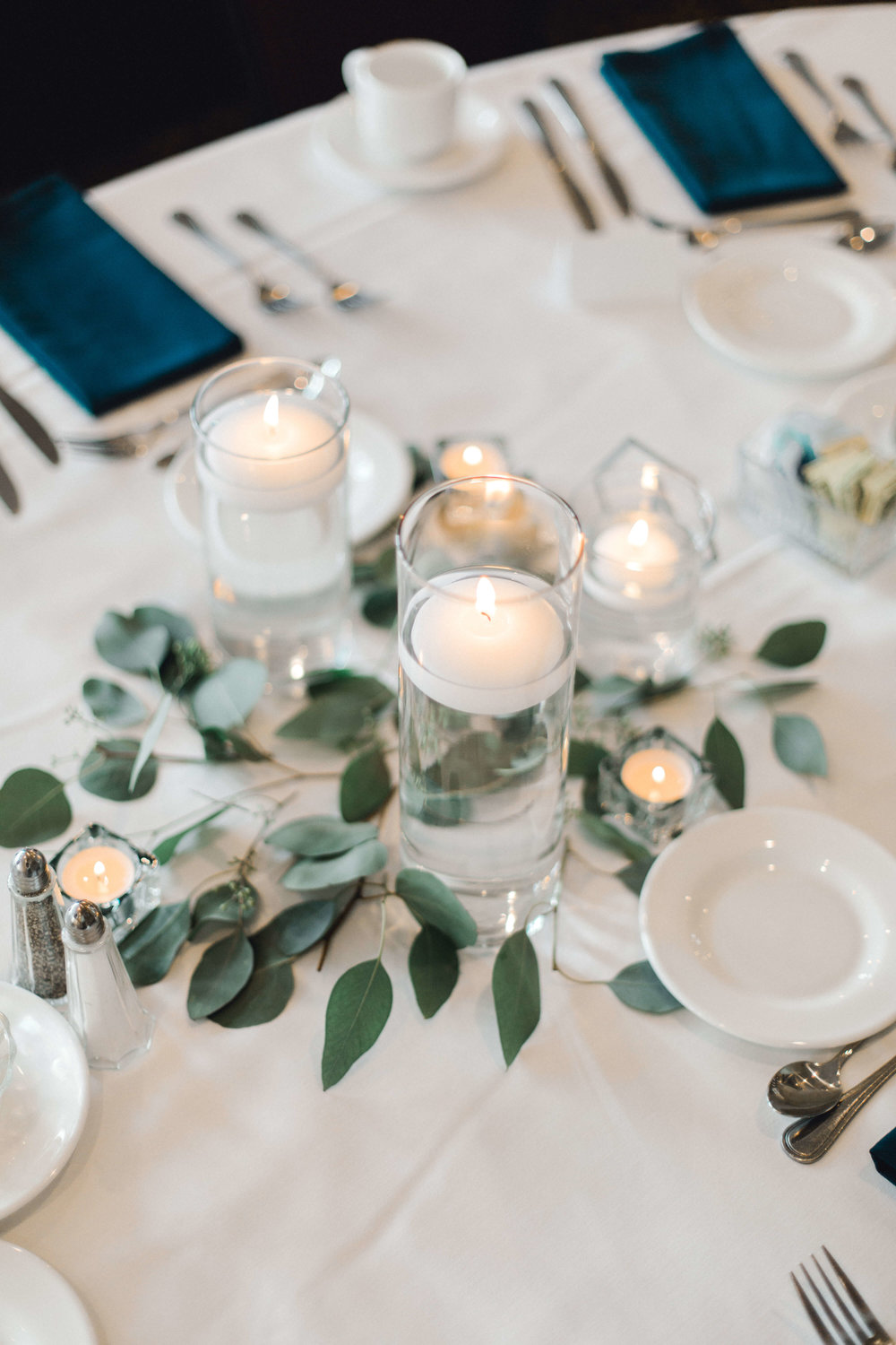 teal napkins, cylinder vases with floating candle and greenery | Lauren Baker Photography | Sixpence Events Blog Post: Must Have Wedding Photography Tips