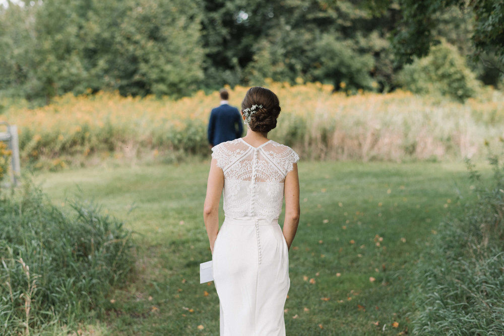 first look in the field | Jonny and Liz Minnesota Wedding Photographers | Sixpence day of coordinating at Gale Woods farm venue near the lake.JPG