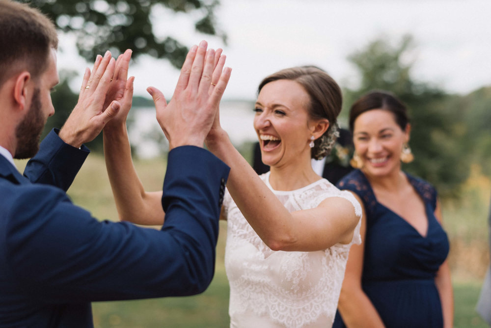 bride and groom high ten! | Jonny and Liz Minnesota Wedding Photographers | Sixpence day of coordinating at Gale Woods farm venue near the lake.JPG